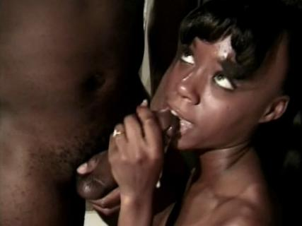 Black whore giving blowjob to a horny dude on her knees from Free Blowjob Passport